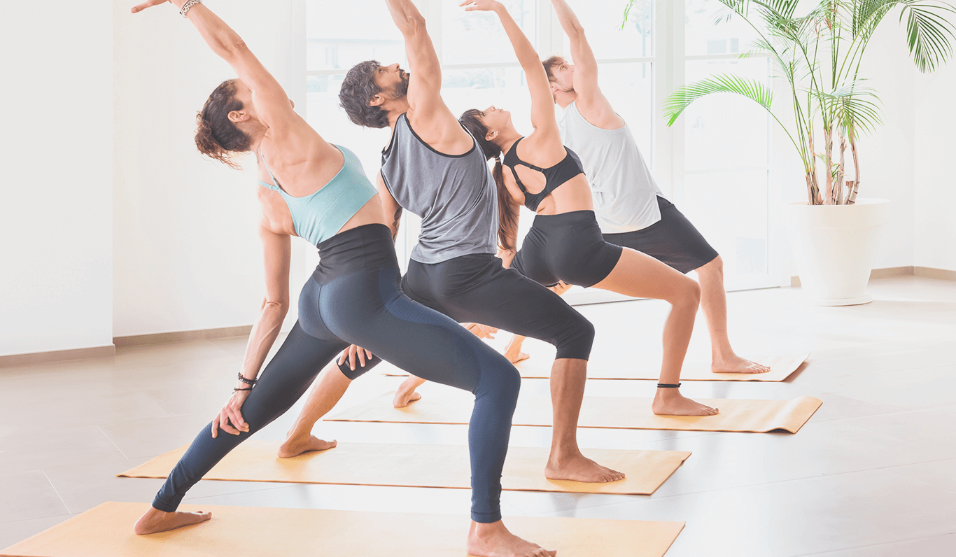 4 people doing yoga inside