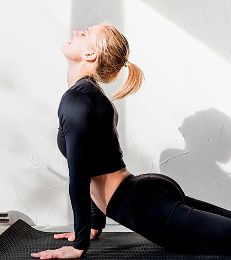 woman doing the cobra pose (yoga)